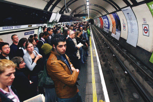 29 May 2007, London, England, UK --- Londoners wait for an subway in central London. Known for it its frequent delays, engineering works and cancellations, the tube challenges the patience of the Londoners who greatly depend on it.  --- Image by © Andy Rain /epa/Corbis