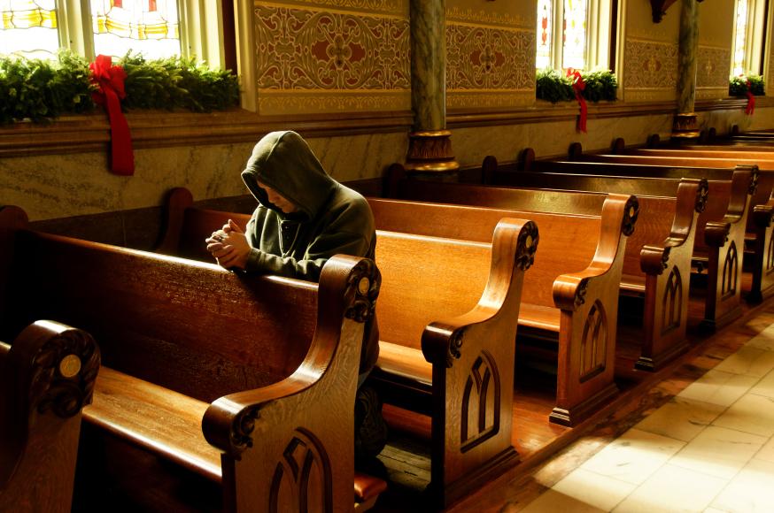 web-person-praying-knees-church-waddell-imagesshutterstock-cc